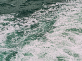 Close-up view of churning white wake, from the back of a boat crossing the English Channel.