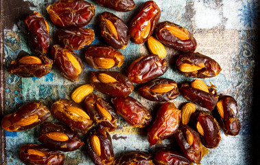 Fresh dates with almonds on a table