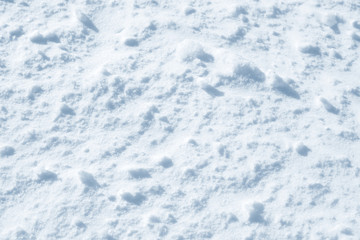 Fresh snow background texture. Winter background with snowflakes and snow mounds. Snow lumps.