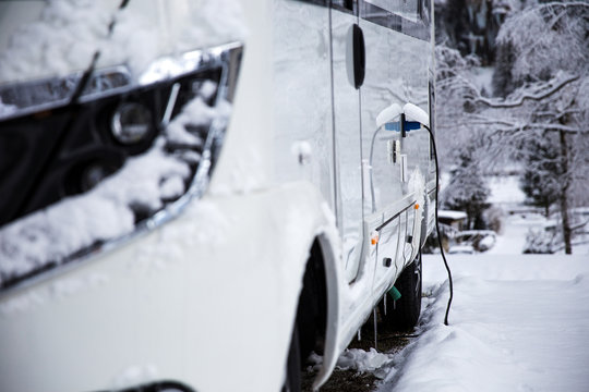 Electricity connection on a rv in the winter time. winter camping in the mountains.