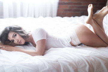 Sexy woman in t-shirt and panties