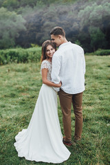 Young smiling couple holding on perfect landscape! Married people! Wedding time!