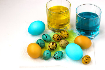 Yellow and blue chicken and quail eggs for Easter, Spring holiday concept