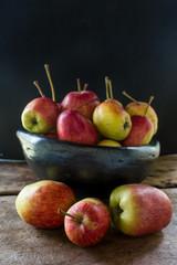 still life of apples in black clay bowl