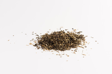 Pile of green tea isolated on white background