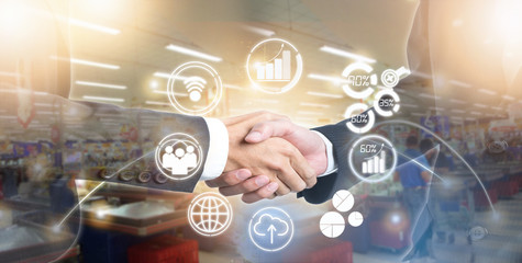 Double exposure of shaking hand business people for success deal on marketing online with new icon