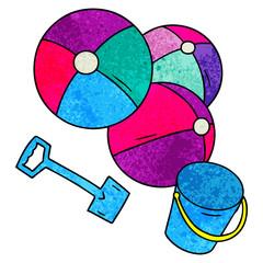 textured cartoon doodle beach balls with a bucket and spade