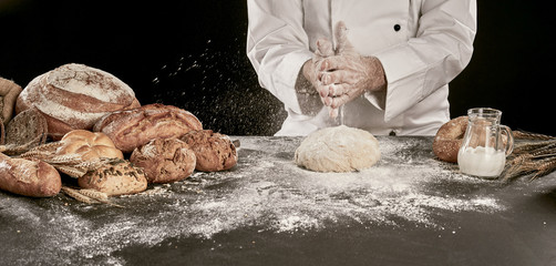 Chef flouring his dough with his hands