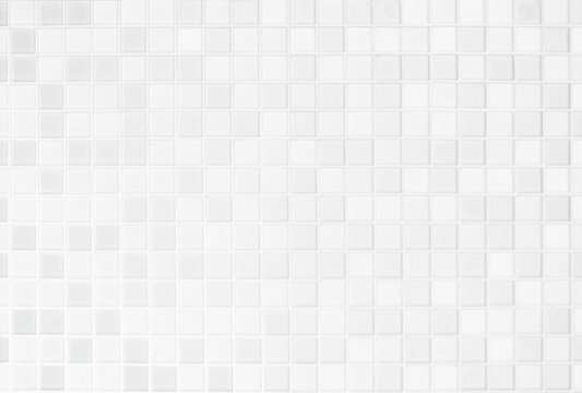 White or gray ceramic wall and floor tiles abstract background.