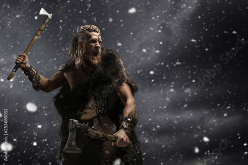 Medieval Warrior Berserk Viking With Tattoo And In Skin With Axes