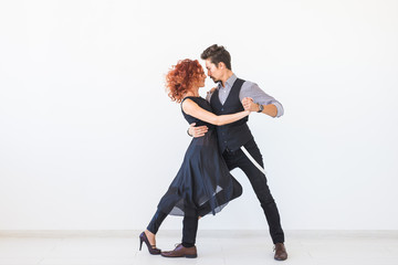 Printed kitchen splashbacks Dance School Social dance, kizomba, tango, salsa, people concept - beautiful couple dancing bachata on white background with copy space