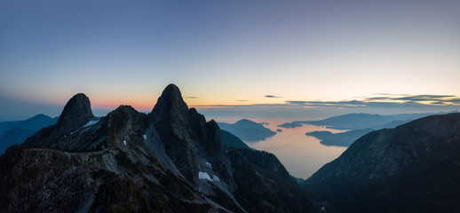 Aerial panoramic view of the Beautiful Canadian Mountain Landscape during a sunny summer sunset. Taken in Howe Sound, North of Vancouver, British Columbia, Canada. Wall mural