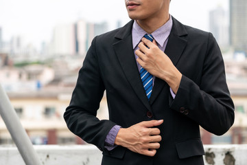 Body of businessman wearing formal business suit. Workplace fashion.
