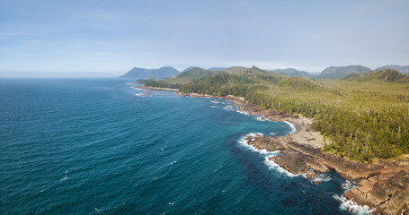 Beautiful aerial seascape view on the Pacific Ocean Coast during a vibrant summer day. Taken in Northern Vancouver Island, British Columbia, Canada.