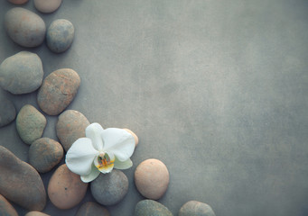 Fotobehang Spa concept with basalt stones and white orchid