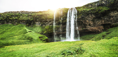 Magical Seljalandsfoss Waterfall in Iceland. It is located near ring road of South Iceland. Majestic and picturesque, it is one of the most photographed breathtaking place of Iceland.