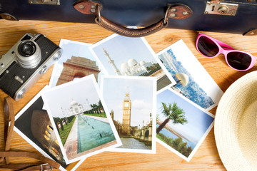 Old retro pictures and camera on wooden table globetrotter photography travel concept