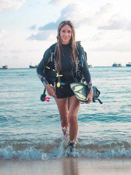 Working mum, super mum. PADI Scuba  Diving Woman with equipment  in the poolside