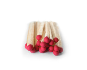 Pile of wooden matches on white background