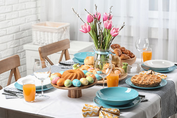 Festive Easter table setting with traditional meal at home