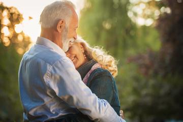 Happy senior couple in love. Park outdoors.