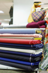 Various multicolored textiles for sale in  shop