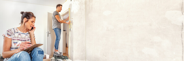Young couple making plans while renovating the new dwelling, xxl+more: bartussek.xmstore
