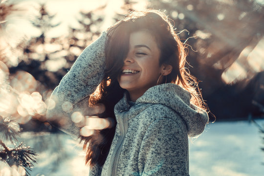 Woman enjoys a winter sunny day