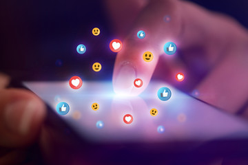 Finger touching phone with social media concept and dark background