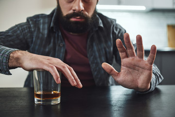 Canvas Prints Bar Forget past mistakes. Forget failures. Forget about everything except what you're going to do now – and do it. Addicted man refuses to drink a glass of whiskey. Cropped image. Selective focus