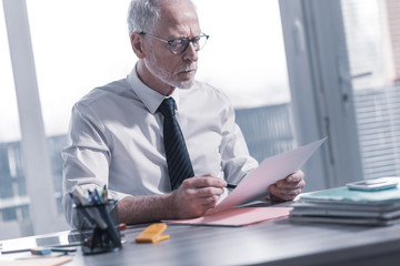 Businessman checking a document
