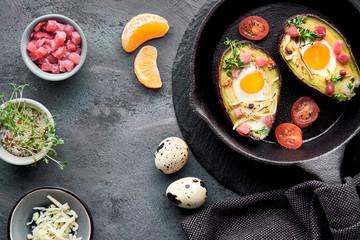 Keto diet dish: Avocado boats with ham cubes, quail eggs, cheese
