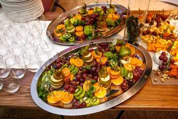 Plate with fruits and berries on table, event catering.