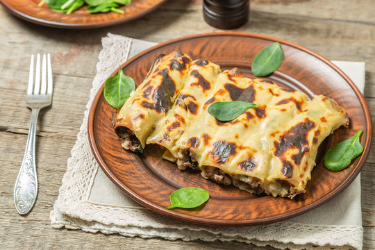 Cannelloni with minced beef and spinach baked in béchamel sauce.
