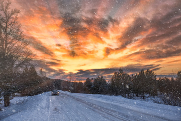 Beautiful road in a snowy winter evening
