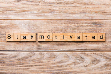 Stay motivated word written on wood block. Stay motivated text on wooden table for your desing, concept