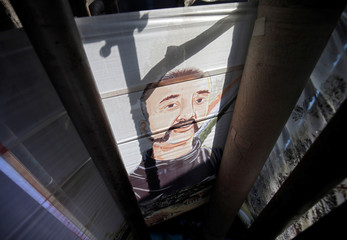 An image of Indian Air Force pilot Abhinandan Varthaman, who was captured and later released by Pakistan, is seen printed on a sari on a conveyor inside a sari manufacturing factory in Surat