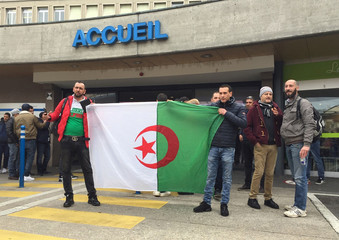 People stand outside the HUG in Geneva