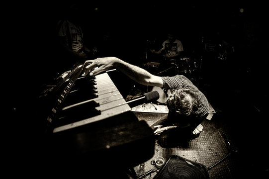 Musician playing the piano dramatically