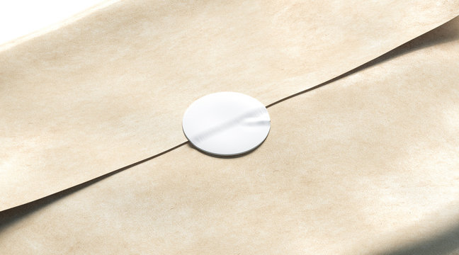 Blank white adhesive round sticker on craft wrapping paper mockup, 3d rendering. Empty delivery pack with glue stick mock up. Clear product crumpled package with badge template.