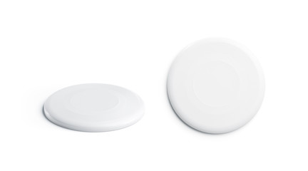 Blank white plastic frisbee mockup, isolated, top and side view, 3d rendering. Empty playing frisbe mock up. Clear disk for activity. Outdoor sports for company template..