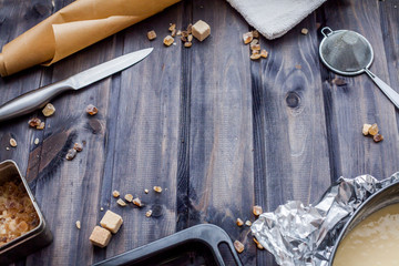 Cooking dough, cooking equipment, flour on a wooden table. Top view with copy space, mockup for menu, recipe. Baking background.