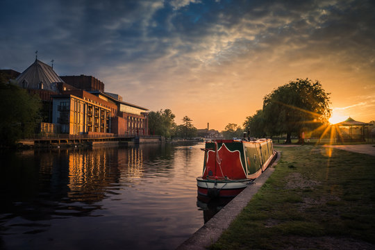 Stratford upon Avon river with Theatre and Narrowboat at sunrise