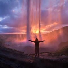 Behind famous Seljalandsfoss waterfall on south Iceland