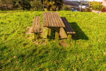 Italy, Lecco, Lake Como,  wooden bench on a lawn