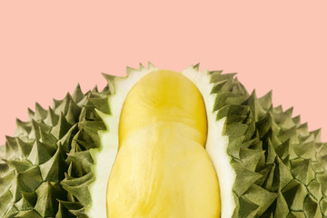 Fresh cut durian on a pink background, king of fruit from Thailand, creative summer food concept with copy space
