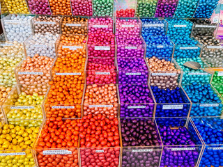 Multicolor store front or supermarket with Chocolate eggs in colorful foil for easter