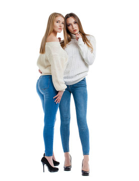Two women in blue jeans and white sweater