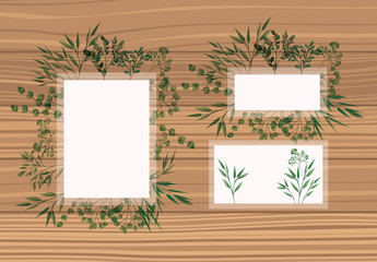 set of frame with laurel leafs wooden background