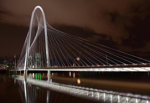 Dallas skyline and famous bridge reflecting in Trinity River